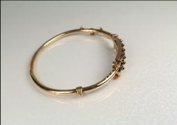 Gold victorian bangle with safety chain