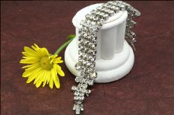 Rows of crystal RS wide silvertone bracelet