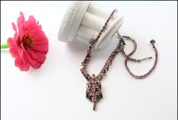 Pink rounds and silver gray baguettes extends up the necklace strand