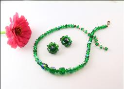 An older vintage, deep green crystal necklace and earring set
