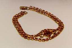 Charming amber double row RS with loads of dazzle at center front