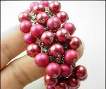 Loaded with beads, red babble expansion bracelet