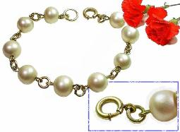 Antique sim pearls surround the entire bracelet; closes with a thumbless nib-less spring ring