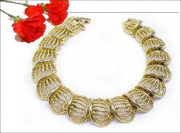 A very pretty golden woven high arched vintage bracelet