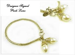 Vintage signed Park Lane on hand tage, golden snake chain with pearl dangles at ends