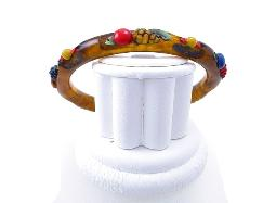 Round bakelite bracelet with colorful enamel fruit atop