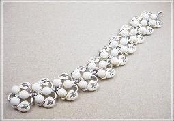 Beautiful, white enamel leaves along with white lucite round beads