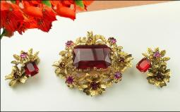 Austria signed golden and red crystal brooch pin