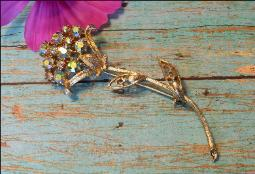 Long goldtone flower pin brooch