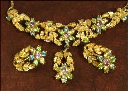 The choker is a beautiful golden with multi colored rhinestones making up pastel flowers
