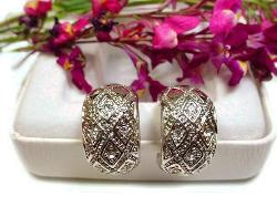 Heavy Stylized Silver Earrings