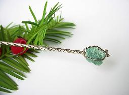 Silver Spoon Handle Holds A Greenish Blue Stone