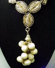 Filigree center front, filigree motifs filigree wire twisted into refined motifs centered with elegant little balls