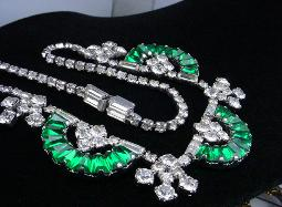The juxtaposition mix of articulated blueish green and crystal baguette necklace