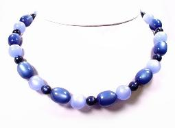 Vintage blue thermoset with elongated oval and round glowing beads