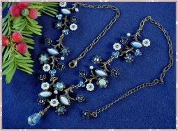 Contemporary necklace features florals
