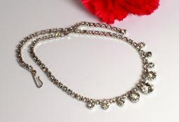 Bright silvertone, this stunning collar necklace