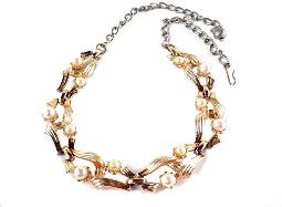 Vintage Gold and Silver linked vintage necklace, set with beautiful swaying ribbons