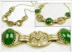 Features Oval Green Cabochons and Stylized Flowers