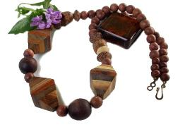 An older layered wood necklace, each larger bead is multi layers of different wood types