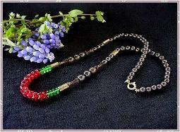 Reds greens and metalics one strand necklace