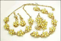 Four piece parure consist of a necklace, earrings, brooch, and bracelet