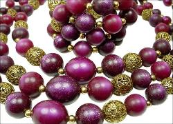 The pieces are over the top in colors of purples, lavenders, and golden filigrees