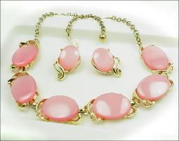 Pink thermoset necklace and earrings in a modern gold tone set