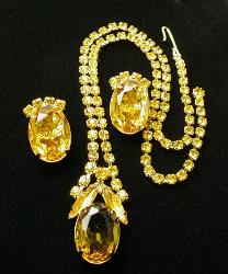 Set with slender navettes surrounding a large oval stone, and round rhinestones