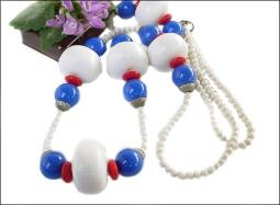 A Stagement Piece art deco necklace in reds whites and blues vintage plastics
