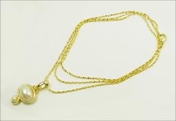 Golden oval white pearl cabochon necklace
