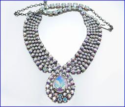 A True Beauty - Paved necklace with 5 rows of colorful RS with a large pendant center front, turely amazing