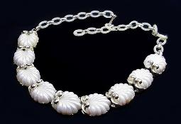 A very old vintage pearlized thermoset necklace with plastic extension links