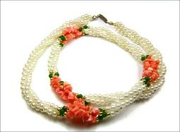 Three strand pearl necklace with green stones, and coral