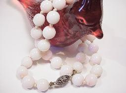 One strand of thirty five hand knotted mother of pearl or coral in RARE white with pink