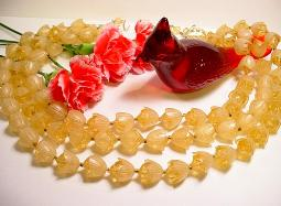 Molded vintage plastic necklace, three strands of flowers