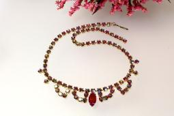 Vintage necklace, a single strand of fascinating red ab rounds with swags of matching stones