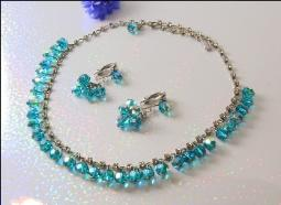 Teal Blue Crystals Dangles Stately Around the Neck