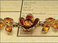 Citrine and amber colors with flowers and leaves on a gold tone
